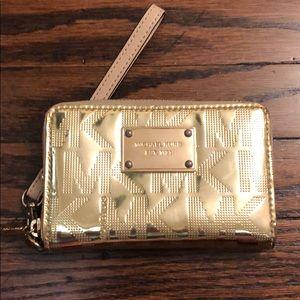 Michael Kors Wristlet Wallet. Gold Metallic